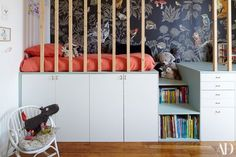 "For Auguste's room, Colombet designed a custom bed and storage system to hide his toys and prop up a pint-size mattress. She and Auguste's dad installed the setup as a surprise. ""Auguste was with my father for two days,"" Colombet recalls. ""He discovered his 'hut' when he came home."" 