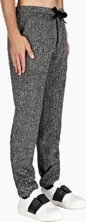Valentino Herringbone Pattern Wool Trousers The Valentino Mens Herringbone Pattern Wool Trousers for AW14, seen here in grey and black. - - Blending a heritage fabric with a more relaxed, casual silhouette, these trousers from Valentino are cra http://www.comparestoreprices.co.uk/january-2017-6/valentino-herringbone-pattern-wool-trousers.asp