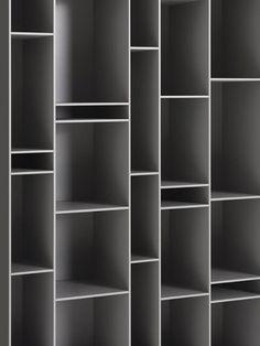 Bookshelf design, modern bookcase. Random contrasting.