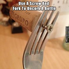 Use A Screw And Fork To Uncork A Bottle