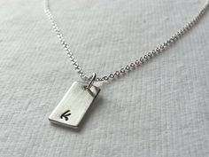 Tiny Sterling Silver Hand Stamped Initial Necklace Bar Charm, Mother Jewelry, Mom, Personalized, Simple, Minimal. $25.00, via Etsy.