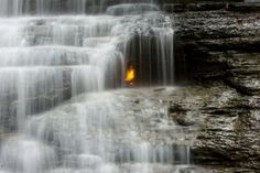 Located behind a waterfall in Shale Creek Preserve south of Chestnut Ridge Park in Northwestern Pennsylvania lies a strange natural flame that is made even more beautiful and odd because you can see it through the falling water of the waterfall. Legend has it the flame was first lit by Native Americans thou