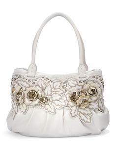 "Brighton's Crysta Satchel is such a ""girlie"" purse... wouldn't this be pretty with a lacy dress or a long eyelet skirt?"