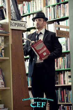 what even was this photoshoot. why are you lighting romance novels on fire, chris?!
