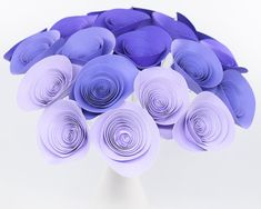 Bouquet of 20 lovely purple paper flowers in 4 different shades of purple! Details- Flowers: 1 1/2 - 2 1/4 in diameter Stems: 9 - 10 silver stems - This bouquet is made and ready to ship, so once you place your order Ill get these blooms in the mail to you the next business day. - Please note that this listing is for the flowers and any other items in the photos are props and not included. - I can make cupcake toppers, loose flowers (table scatter), flower magnets (favors anyone?), garland…