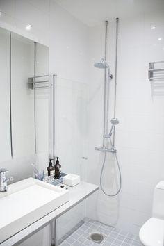 See and Feel Spatial Design, Finland - Interior design - Bright & white Bathroom, concrete sink, rain shower