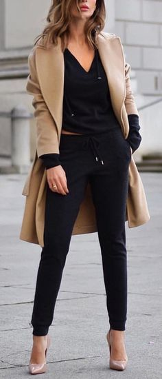 #spring #outfits woman wearing brown coat, black v-neck top, black skinny pants, and nude-colored pointed-toe stilettos outfit. Pic by @fashion.voyage