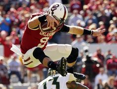 Oklahoma's Trevor Knight (9) leaps over a tackler during the college football game between the University of Oklahoma Sooners (OU) and The Baylor University Bears (BU) at Gaylord Family-Oklahoma Memorial Stadium in Norman, Okla. on Saturday, Nov. 8, 2014.  Photo by Steve Sisney, The Oklahoman