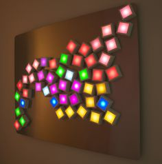 "Zigelbaum + Coelho, ""Six-Forty by Four-Eighty"", 2012, an installation of magnetic moveable pixels (6in cubes) on a wall, MIT Media Lab, MA, USA."