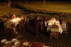 Dinner by spotlight on Kafunta River Lodge's deck