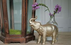 gold spray painted elephants around centerpiece... elephants, tigers, and more