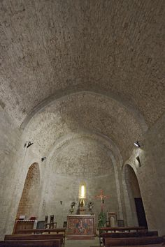 """The abbey of Santa Maria de Lluçà (in fact a priory) takes its name from the medieval """"kastro luziano"""", that means Lucianus' castle. It looks that the place had links to the late antiquity. The present abbey, dating from 1170, is preserved in the church and the small but perfect cloister."""