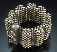 """""""Sterling Accordion"""" Bracelet, 2006   Sterling silver beads and clasp. 3 3/4"""" w. x 1 3/4"""" h. Collection of Irene Austin  Copyright Valerie Hector 2006; all rights reserved.  Photo: Sanders Visual Images.    (click image to view larger in new window)"""