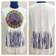"Guns N' Roses Fringe Crop T Shirt Get your festival look with this high quality off white Rock and Roll t shirt. Fringe is extra long. Brand new with tags attached! Medium or Large available. Run big. Measurements are as follows. SMALL Bust 40.2"", Shoulder 15.7"", Length 28.3"" , MEDIUM Bust 42.5"", Shoulder 16.1"", Length 29.1"", LARGE Bust 44.9"", Shoulder 16.5"", Length 29.9"". Ships same day if ordered by 11:00 am CST. Tops Tees - Short Sleeve"