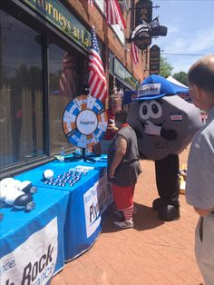 Rachel was spinning the wheel to win a prize during our #FlagDay event at the Plymouth Rock Assurance booth!