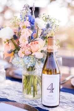31 Unique Wedding Table Number Ideas - wine bottle table numbers {Honey Photographs by Alyss} Unique Centerpieces, Wedding Table Centerpieces, Wedding Flower Arrangements, Flower Centerpieces, Wedding Flowers, Wedding Decorations, Table Decorations, Centerpiece Ideas, Decor Wedding