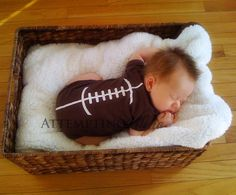 Oh my! This football baby onesie made us smile. Make your own with a brown onesie and vinyl strips.