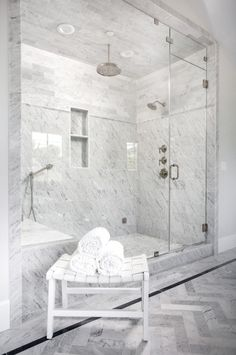 white leather basketweave bench sits on gray herringbone floor tiles in front . A white leather basketweave bench sits on gray herringbone floor tiles in front .,A white leather basketweave bench sits on gray herringbo. White Tile Shower, White Marble Bathrooms, Marble Showers, Tile Showers, Bathroom Showers, Bathroom Ideas, Master Bathroom Shower, Bathroom Floor Tiles, Bathroom Shower Curtains