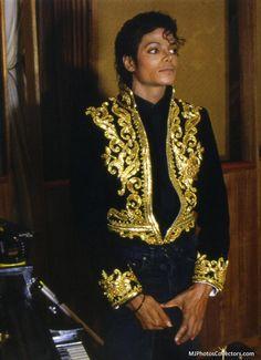 USA/ Africa We Are The World Jacket Vest: Black Blouse, Black Jacket with gold imprint and gold design. Black Jeans