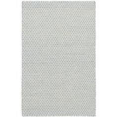 This woven wool area rug, featuring an intricate geometric pattern in French blue and ivory, is sweet enough for bedrooms or family areas, yet durable enough for the living room, hallway, or even the kitchen.
