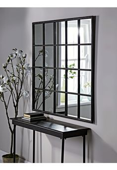 With a gently distressed black iron finish and twenty mirrored panels, our bold industrial style window mirror will make a statement in your living space. Inspired by our bestselling window mirror collection, it encapsulates factory chic with a Decor, Windows, Window Design, Window Mirror Decor, Living Room Mirrors, Mirror Decor, Iron Decor, Iron Console Table, Mirror