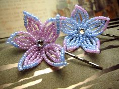 Two french beaded flower hair bobby pins in lilac pink with perwinkle blue edge and periwinkle blue with lilac pink edge. The twins that are as similar