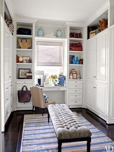 At the Los Angeles home of Lucky Brand executives Patrick Wade and Dave DeMattei, a custom-made bench by Erinn V. Maison rests on an antique dhurrie in the master suite's dressing area, which features ample storage and a built-in vanity | archdigest.com