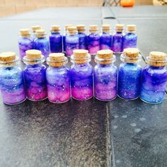 Mini Galaxy in a bottle charms ( done by me)