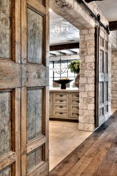 Beautiful sliding barn door entering the kitchen.