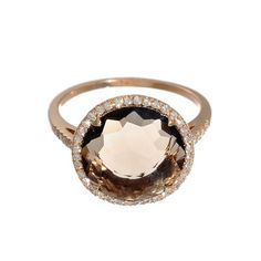 gold ring features a gorgeous smoky quartz center stone surrounded by a pave diamond