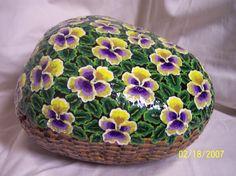 Flower basket painted on rock. By Linda Hallett