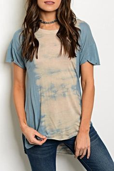 """Short sleeve scoop neck tie dye tee. Has side slit detail. Country: CHINA Fabric Content: 100% RAYON Size Scale: XS-S-M-L-XL Description: LF: 23"""" LB: 27"""" B: 36"""" W: 38"""" Model is wearing a small. Blue Tiedye Tee by Moon  Arrow . Clothing - Tops - Tees & Tanks Colorado"""