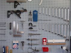 3/4 of the walls of my garage are pegboard, best idea I ever had