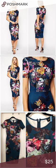 ASOS Navy Floral Print dress Stunning flora print on a navy background. Stretchy body slimming fabric. Zipper in back. Excellent condition. The back zipper is missing the little hook for the clasp but the zipper stays put on its own. ASOS Dresses