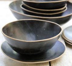 lovely black bowls with plates for soup or salad or cereal.... $34.00, via Etsy.