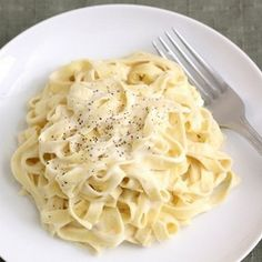 Lighter Fettucine Alfredo: a sauce that's still cheesy and creamy without all of the fat!