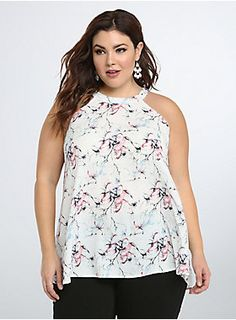 """<p>Take notes, ladies; this top is the only sophisticated piece you'll need to pass the style test. An elegant mock neck lends a tasteful touch to the beautiful floral print chiffon. While the front is covered-up, the cut-away tulip back reveals a flash of skin.</p><p></p><p><b>Model is 5'9"""", size 1</b></p><ul><li>Size 1 measures 29 1/2"""" from shoulder</li><li>Polyester</li><li>Wash cold, dry flat</li><li>Imported plus size tank</li></ul>"""