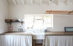 love the wood counter and the skirt. Via the Paper Mulberry