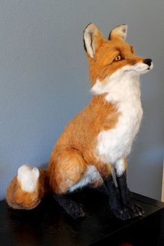 Needle felted fox sculpture by Yvonne's workshop. Find me on etsy and facebook. This fox is 22 inches tall.