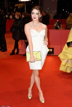 Not playing games: Maisie Williams looked stylish in a white mini-dress and yellow accesso...