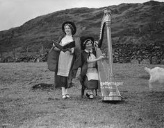 Two members of the Eryri Harp Choir rehearsing in a field at Hafod Y Porth near Bedgelert.