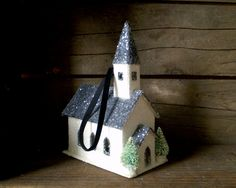 Completely handmade by me, this little black and white church was inspired by holidays in simpler times. Perhaps Victorian, perhaps 1920s, I haven't decided in which era it belongs.   The church measures approximately 2.5 x 4.5 inches with a maximum height of 6.5 inches at the spire. It comes with a 4.5 inch black velvet loop securely attached from the inside. The loop can be removed if you want to display the church on your mantle or side table.