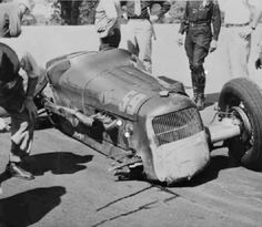 Andy Granatelli smacked the wall in his Miller in 1948 and failed to qualify for that year's Indy 500. R.I.P., Andy.
