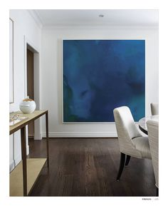 Gorgeous dark hardwood floors, contemporary dining room, peaceful, modern blue painting