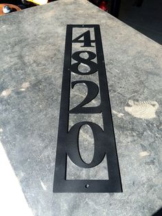 This custom metal address sign will put your house on the map. It has a modern look and precut holes for easy installation. This product is personalized with you own house number and will make a great addition to any front porch or side of mailbox. Farmhouse House Numbers, Metal House Numbers, House Address Sign, Address Plaque, House Address Numbers, 3 House Number, Personalized Housewarming Gifts, Custom Metal Signs, Garage