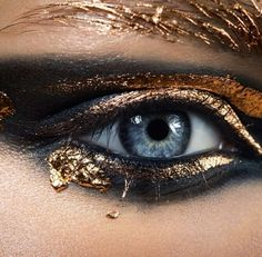 Make-up-is-an-art: MUA: Karim Rahman with blue eyes makeup using black eyeshadow, black eyeliner as well as gold #eyeshadow and gold #eyeliner in a creative way. Notice how the eyebrows have a gold coating as well to match the #eyemakeup art. Needed a stunning bold voluminous and lengthy set of #FalseEyelashes to match and contrast the #BlueEyes