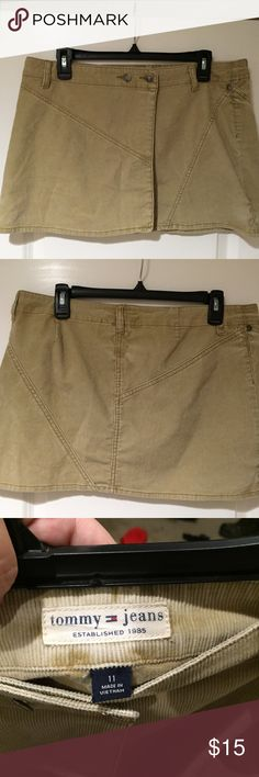 "Tommy Jeans very mini corduroy wrap skirt size 11 Tommy Jeans size 11 corduroy skirt. VERY SHORT 13"" from waist to hemline. Belted waist with 2 buttons. Wraps around waist -last pic shows it in one piece. In awesome condition. Tommy Jeans Skirts Mini"