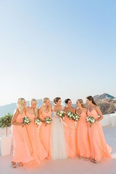 Destination wedding in Santorini| Tie the knot in Santorini- Bridesmaids dresses in peach
