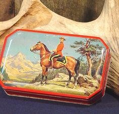 Vintage Royal Canadian Mountie Tin Box, via Flickr.