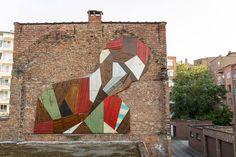 Stefaan De Croock transforms discarded wooden doors and panels into giant murals